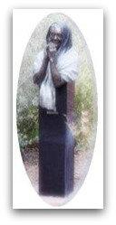 Statue of praying monk in a Sedona, AZ garden